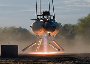 Propulsion - Armadillo Aerospace's quad rocket vehicle showing visible banding (shock diamonds) in the exhaust plume from its propulsion system
