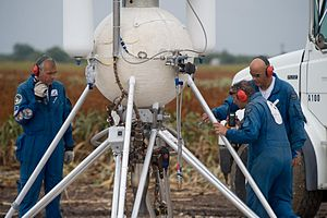 Lunar Lander Challenge - Armadillo Aerospace technicians on the launch pad performing a vehicle inspection.