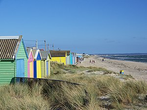 Beaches in Port Phillip - The beach at Aspendale has several colourful beach huts.