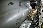 Australian C-47D being secured inside a USAF C-17 Globemaster in 2006.jpg