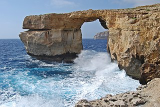 Azure Window Former natural limestone arch in the Maltese island of Gozo