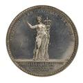 Baksida av medalj med bild av kvinna i antik dräkt samt text - Skoklosters slott - 99525.tif