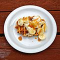 Banana, ice cream and toffee sauce on waffle at The Queen's Head, Boreham, Essex, England.jpg