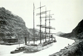 Barkentine John Ena being towed through Panama Canal.png
