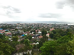 Baubau as seen from the Buton Palace Fortress, with the island of Muna in the distance.