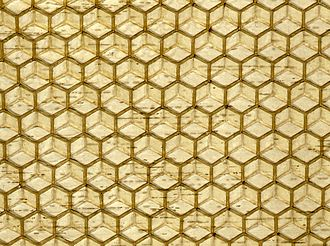 Wax - Commercial honeycomb foundation, made by pressing beeswax between patterned metal rollers.