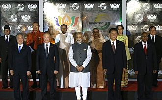 8th BRICS summit - Group photo of BRICS leaders with heads of delegations of BIMSTEC member states before their meeting.