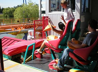 Behemoth (roller coaster) - Passengers board the Red train and secure their harnesses at the station