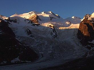 Piz Argient - Bellavista (left and centre), Piz Argient (snowy dome, right) and Crast' Agüzza (rocky peak, extreme right)