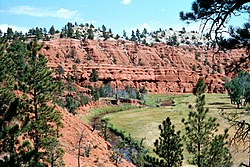 Red sandstone and siltstone cliffs above the Belle Fourche River