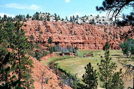 Red sandstone cliffs in the Black Hills Wyoming, former Kiowa territory which remains a sacred area to them in modern times. Belle Fourche River 19A.JPG