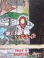 Bethlehem wall graffiti Razan with flower.jpeg