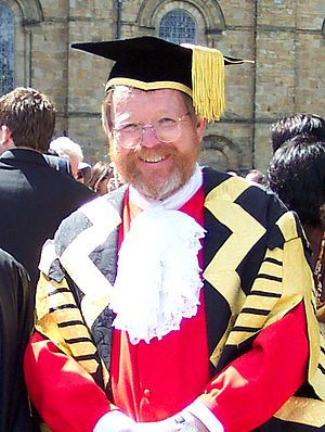 Bill Bryson - Bryson in the regalia of Chancellor of Durham University, with Durham Cathedral in the background