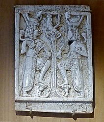Plaque fragment: Egyptian-style scene - The Birth of Horus. Carved elephant ivory embellished with gold