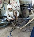 Blacksmith in his workshop.jpg