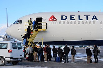 Cold Bay Airport - Passengers boarding a Boeing 767 to complete their flight to Portland after their flight was diverted due to an engine issue with the first aircraft