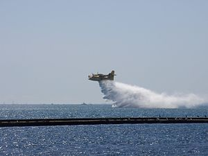 Canadair CL-415 - A Ministry of Natural Resources (Ontario) CL-415 empties its tanks into Lake Ontario.
