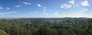 Bowral - Panoramic view of Bowral from the Bowral Lookout on Mount Gibraltar. Moss Vale and the ranges near Bundanoon can be seen in the background.