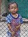Boy Behind Fencing - Old Town - Lampang - Thailand (34387550453).jpg