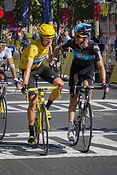 0acf3fe92 Bradley Wiggins crosses the finish line on the Champs-Élysées with Michael  Rogers to win the 2012 Tour de France