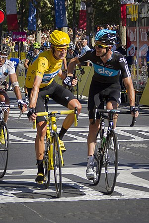 Team Sky - Bradley Wiggins crosses the finish line on the Champs-Élysées with Michael Rogers to win the 2012 Tour de France