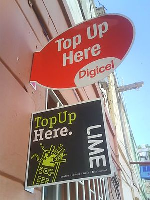Prepay mobile phone - Typical signs showing where top ups can take place.