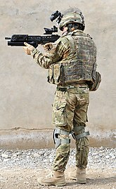 British Army Soldier in Full Kit in Afghanistan MOD 45152581.jpg