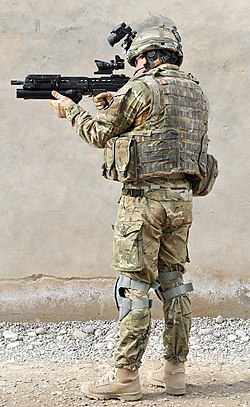 A British Army infantryman showing full combat dress and standard personal kit (back)