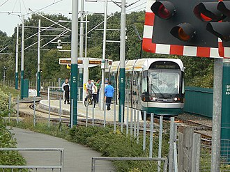 Bulwell Forest tram stop - Bulwell Forest tram stop; the railway is behind the green fence