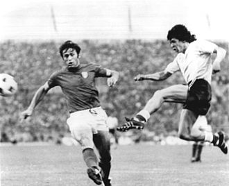 René Houseman - Houseman (right) kicking the ball while Italian defender Tarcisio Burgnich tries to stop him, at the 1974 FIFA World Cup