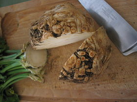 A celeriac hypocotyl sliced in half, and with the greens removed