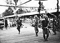 COLLECTIE TROPENMUSEUM Dans door een groep Moealang Dajak mannen tijdens het bezoek van Gouverneur-Generaal J.P. Graaf van Limburg Stirum aan Borneo TMnr 60018472.jpg