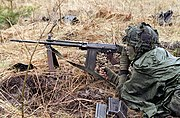 Canadian soldier with C2 DA-SC-84-02213