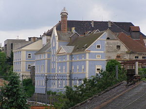 Potemkin village - Because of a newly painted façade, the whole building looks as if it has been reconstructed although the rest is still in decay (castle brewery in Kolín, Czech Republic)