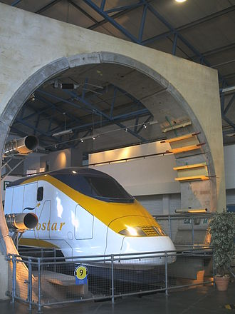 Channel Tunnel - The Channel Tunnel exhibit at the National Railway Museum in York, England, showing the circular cross section of the tunnel with the overhead line powering a Eurostar train. Also visible is the segmented tunnel lining