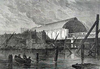 Charing Cross roof collapse - Charing Cross railway station nearing completion in 1864, showing the western sidewall and arched ironwork at the river end that collapsed in 1905.