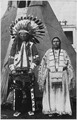 Circus Sarrasani - Two Sioux Indians in native dress in front of teepee - NARA - 285599.tif