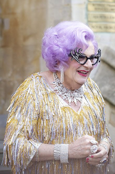 "Melbourne ""housewife"" Edna Everage (a comic creation of performing artist Barry Humphries), first appeared on Australian television in the 1950s. Dame Edna at the royal wedding cropped.jpg"