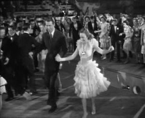 Beverly Hills High School - In It's a Wonderful Life: George (James Stewart) and Mary (Donna Reed) are dancing at the Bedford Falls High graduation party, in reality the gym of Beverly Hills High School