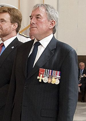 New Zealand Royal Honours System - David Ledson, former chief of the Royal New Zealand Navy, wearing the badge for the Officer rank of the New Zealand Order of Merit.