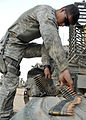 Defense.gov News Photo 100610-N-6903G-010 - U.S. Army Pfc. Jeffrey Brunk Bravo Company 5th Battalion 20th Infantry Regiment 2nd Infantry Division loads ammunition for an M-240B machine.jpg