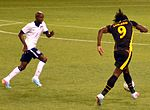 Demarcus Beasley and Romelu Lukaku USA vs Belgium.jpg