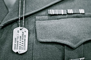 "Social Security number - Dog tag from World War II (possibly Army-Air Corps), labeled ""P"" for Protestant."