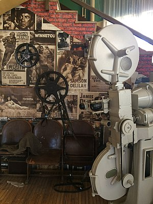 Movie projector - An early projector and seats from a movie theater