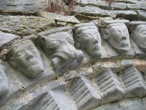 Dysert O'Dea Monastery - The faces found on the outer arch of the doorway