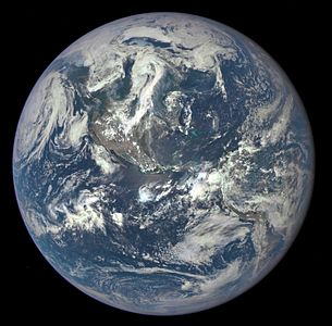 The first DSCOVR EPIC image, released by NASA on July 6, 2015, shows the full sunlit Earth from 916,651 mi (1,475,207 km) away, centered on the Americas.