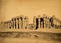 Egypt; a temple in ruins; a man with a camel in the Wellcome V0037708.jpg