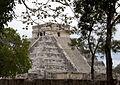 El Castillo through the trees (4387694200).jpg