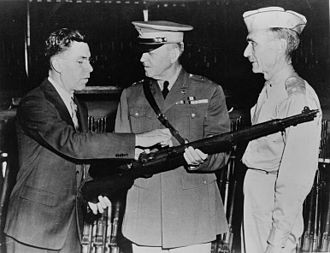 John Garand - Garand points out features of his M1 Rifle to general Charles M. Wesson, the U.S. Army Chief of Ordnance