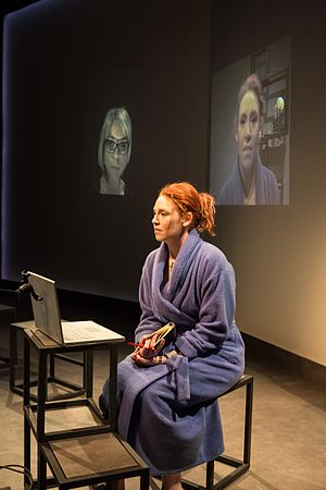 E-baby - Nellie (foreground) with images of both women projected behind, from the Ensemble Theatre's 2016 production, photo by Clare Hawley